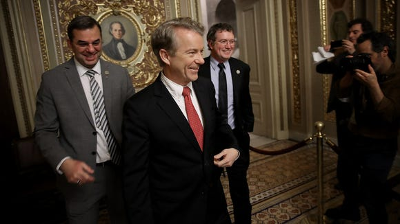 Sen. Rand Paul, center, takes a brief break from the floor of the U.S. Senate to pose for a photo with Rep. Justin Amash, left, and Rep. Thomas Massie in Washington on Feb. 8.