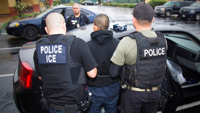 In this Tuesday, Feb. 7, 2017, photo released by U.S. Immigration and Customs Enforcement, foreign nationals are arrested during a targeted enforcement operation conducted by U.S. Immigration and Customs Enforcement (ICE) aimed at immigration fugitives, re-entrants and at-large criminal aliens in Los Angeles.