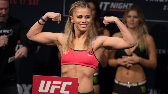 Paige VanZant weighs in for her bout against Michelle Waterson last December.