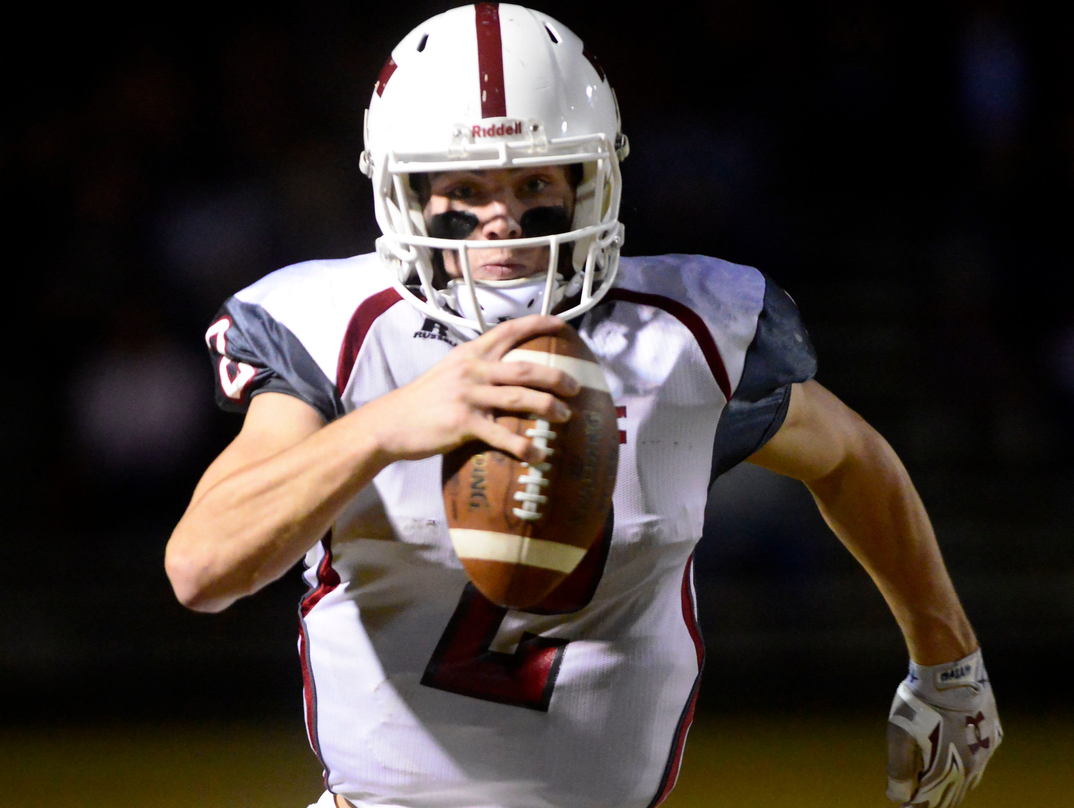 Tate High School quarterback Sawyer Smith keeps the ball Friday while playing Niceville. Tate beat Niceville 21-20 and advance to the Class 6A state semifinals.