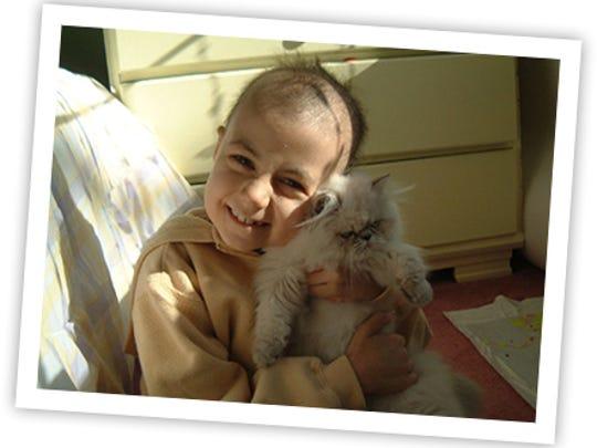 Alex Scott, namesake of Alex's Lemonade Stand Foundation, at age 8 with her cat, Herbert.