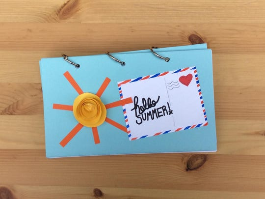 Create a mini book to store photos and keepsakes from summer activities.