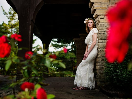 Abby Wolner, 25, models boho wedding style in The Des Moines Art Center Rose Garden.