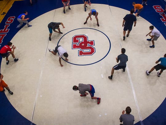 Wrestlers practice in the Spring Grove High School