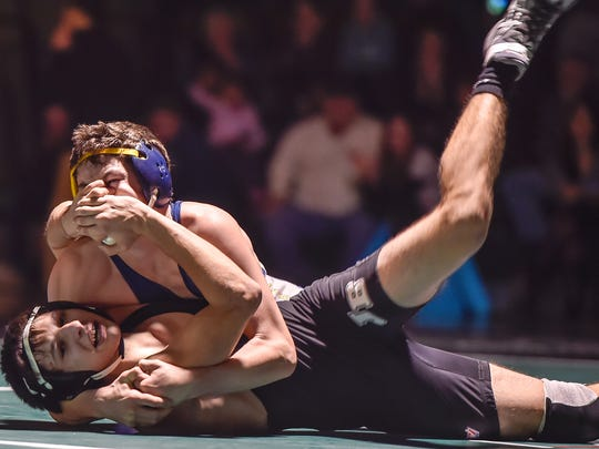 Greencastle's Noah Ezolt has Caden Ficks of James Buchanan on his back during a boys wrestling match on Thursday, Jan. 14, 2015 in Mercersburg, Pa. Ezolt won 8-3 at 152-pounds.