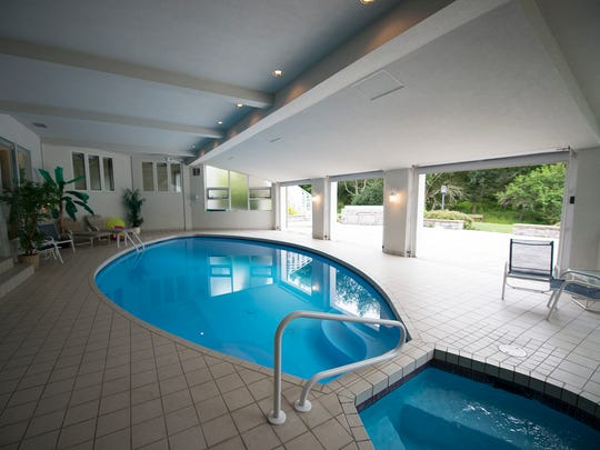 The pool and hot tub with three doors that open up into the lower patio.