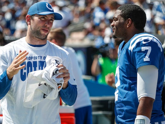 An injured Indianapolis Colts quarterback Andrew Luck (12), left, talks with backup quarterback Jacoby Brissett along the sidelines during the second quarter in the game against the Los Angeles Rams at Los Angeles Memorial Coliseum in Los Angeles on Sunday, Sept. 10, 2017.