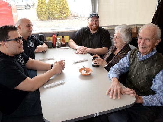 The former owner of the Northville Crossing restaraunt, Alex Alexandris and wife Effie, right, meet its new owner Matt Amin, upper left, and chefs Marino Torres, left, and Jeremy Walker. The restaurant on Northville Road, just south of Seven Mile, was in the hands of the Alexandris family from 1982 until recently and will be known now as the Omelette and Waffle Cafe.