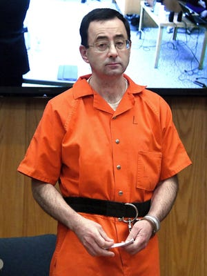 Larry Nassar appears at his sentencing in the court of Judge Janice Cunningham and receives a sentence of 40-125 years in prison on Feb. 5, 2018 in Charlotte, Michigan.