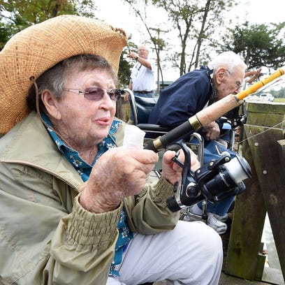 Marcelle Newton of Good Samaritan Society assisted living facility keeps an eye on her line while fishing at Amon's Lake on Tuesday. Mike Jirka of the Rod and Reel Club of Mountain Home hosted the residents, providing rods, reels and bait.