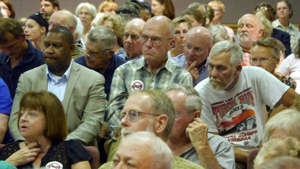 Residents listen to the representatives from Dominion present their proposal for a natural gas pipeline that would run through Augusta County to the Augusta County supervisors August 13, 2014.
