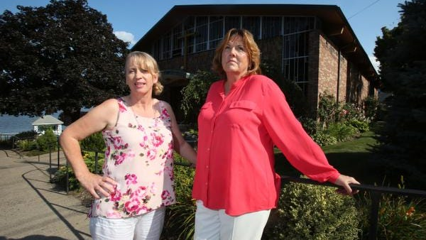 Parishioners Martina Lynch, left, and Ann Collazuol at St. John's Church in Piermont Aug. 26, 2014. The church might be merged with St. Ann's in Nyack.