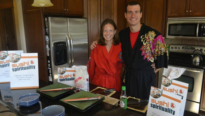 """Carrie and Paul Miller will be wearing kimonos and preparing the main dish as they host the annual Catholic Diocese of Green Bay-sponsored """"Spirituality & Sushi"""" program for young adults at the couple's Ledgeview home Wednesday night."""