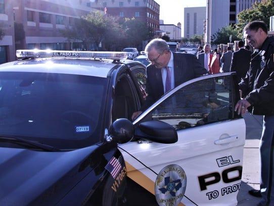 El Paso Mayor Dee Margo gets into a new police car