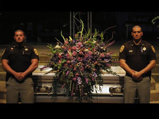 Deputies watch over casket of fallen officer's daughter