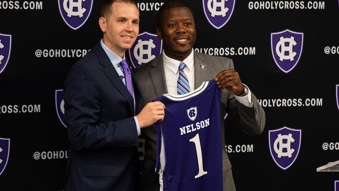 One of the first moves last year for Holy Cross Director of Athletics Marcus Blossom, right, was the hiring of basketball head coach Brett Nelson.