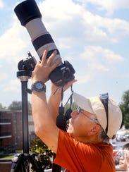 Shawn Zheng photographs the solar eclipse during an