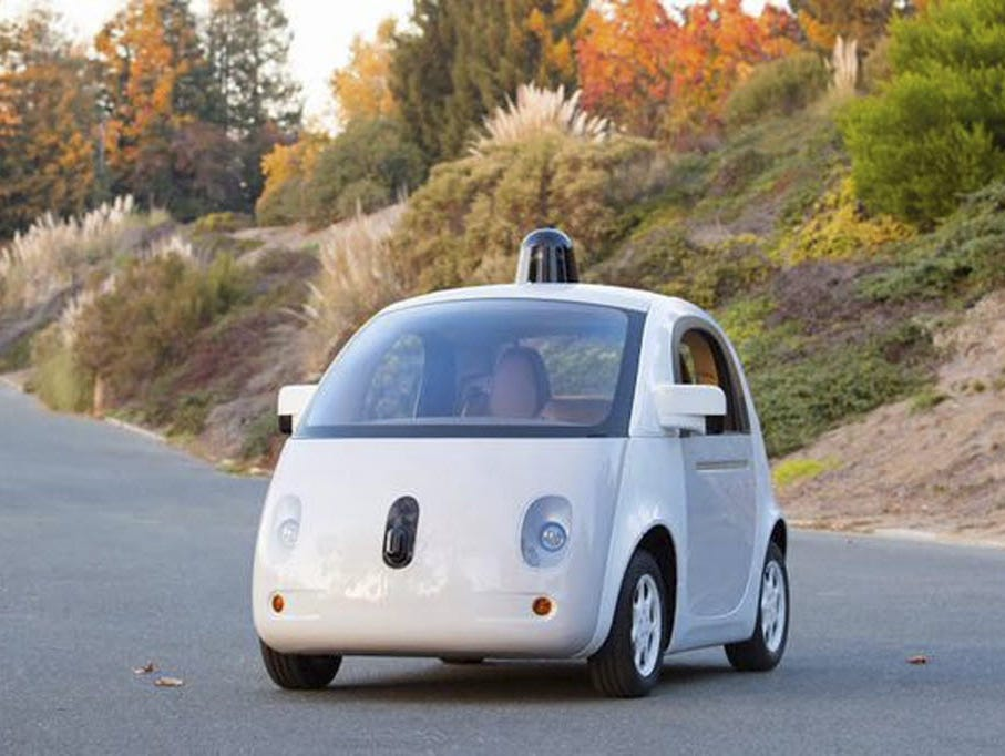 Google is working on a fleet of small self-driving cars, one of which is shown here during a practice run last year at the company's Northern California test facility.