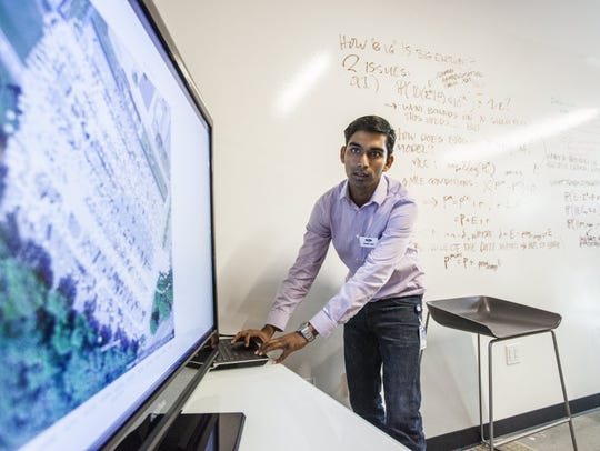 Ford research engineer Jinesh Jain demos a project