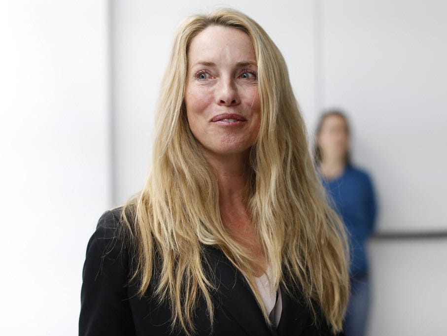 Laurene Powell Jobs, widow of late Apple founder and CEO Steve Jobs, is seen among the crowd after an Apple special event at the Yerba Buena Center for the Arts on March 9, 2015 in San Francisco, California.