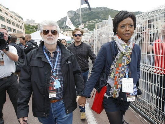 George Lucas walks through the Monaco Formula One paddock