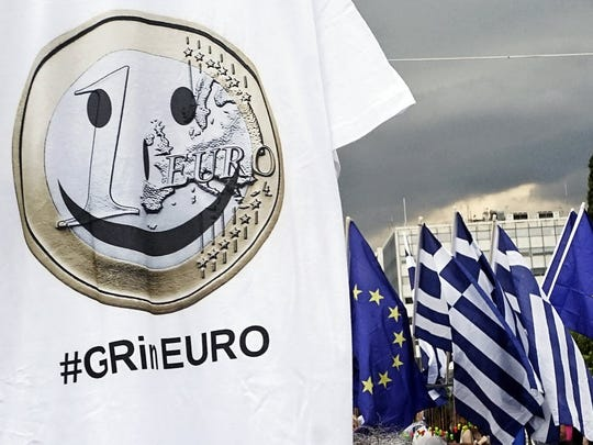 "A T-shirt supports a ""Yes""  vote on Sunday's Greek"