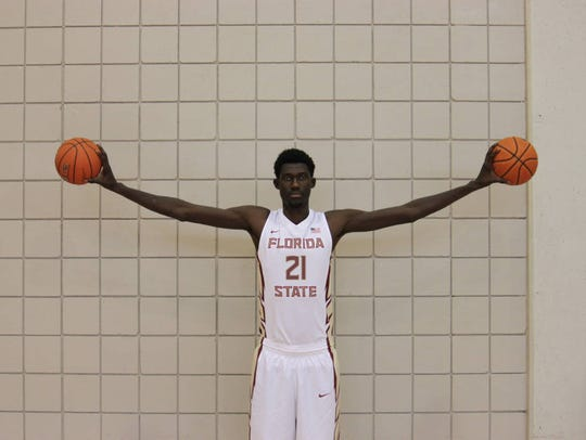 At 7-4, Jean Marc Crist Koumadje is the tallest athlete