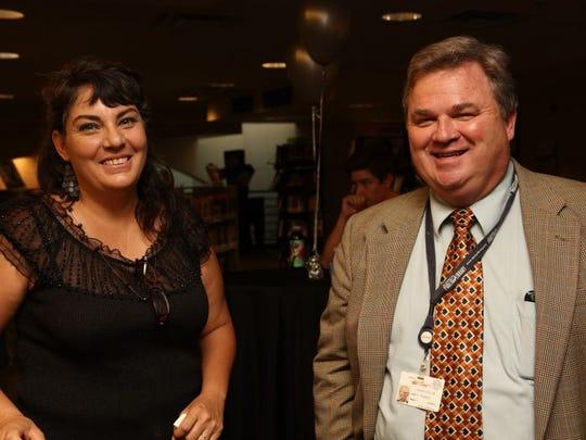 Roxana Mercado, left, and  Mark E. Pumphrey.