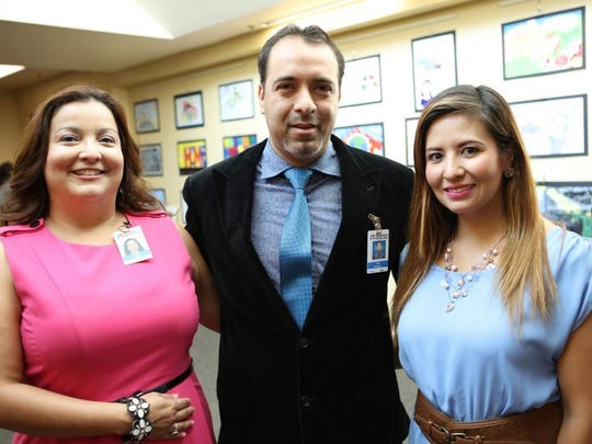 Linda Pena, left to right, Julio Bustillos and Denise Bustillos.