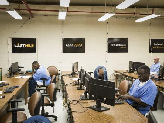 San Quentin inmates participate in a coding class.