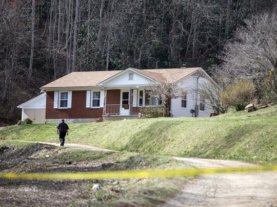 "Buncombe County sheriff's deputies in March investigate at the Leicester home of Joseph ""J.T."" Codd, 45, and his wife, Cristie Schoen Codd, 38."
