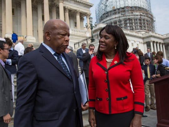 Rep. Terri Sewell, D-Ala., right, talks with Rep. John