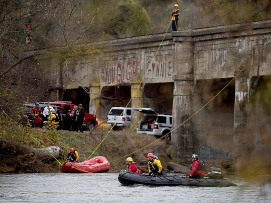 Crews wrap up the day's search for two missing women Nov. 5. One body was recovered from the French Broad River.
