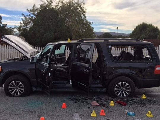 The bullet-riddled SUV authorities say the shooters used in an attempt to run from police.