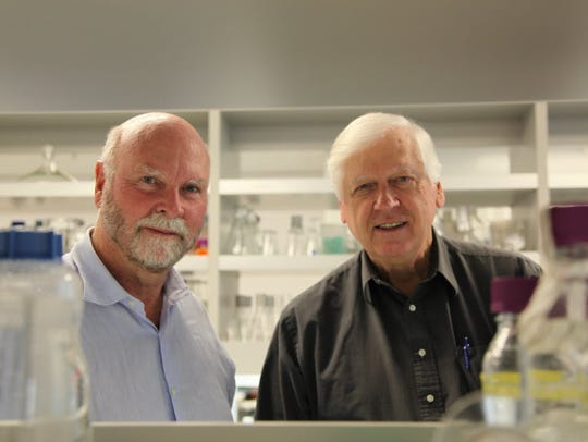 DNA sequencing pioneer J. Craig Venter, left, shown