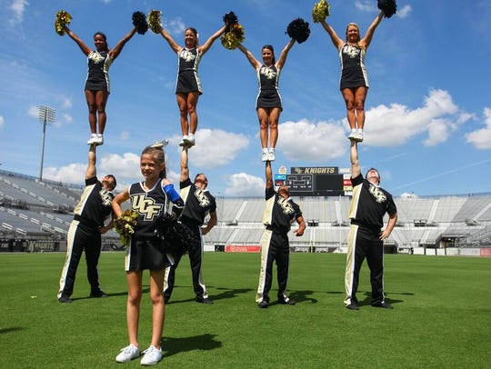 10-year-old Julianna Linton takes the field with UCF's