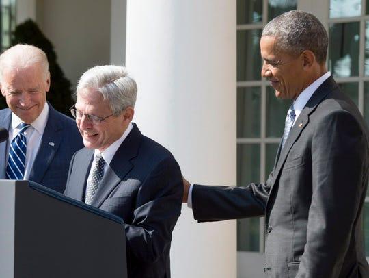 President Obama and Vice President Joe Biden listen