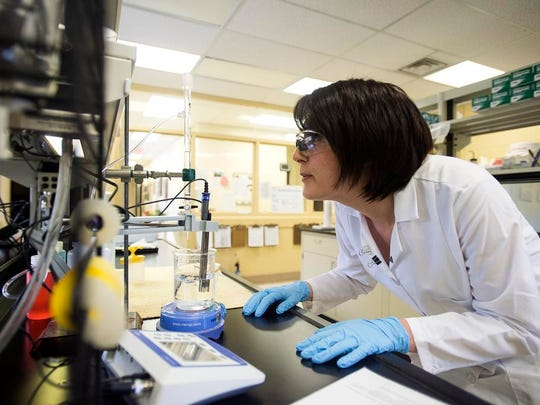 Lab Supervisor Brenna Cook tests the pH of a water sample earlier this month at the North Fork Water Treatment Plant.