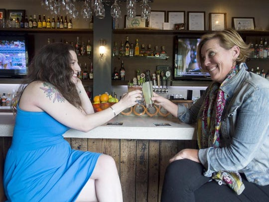 Kris Kraft, left, with Asheville Wine and Food and Mary Rich, right, with Sprit Savvy share a drink at The Social April 21, 2016.