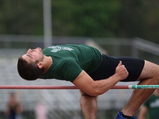 James Buchanan's Chas Shelly clears the bar in the high jump on Tuesday in a dual meet against Greencastle-Antrim.