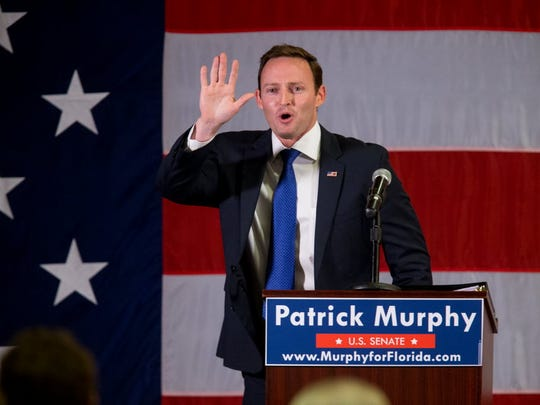 Rep. Patrick Murphy celebrates at the Doubletree Hotel