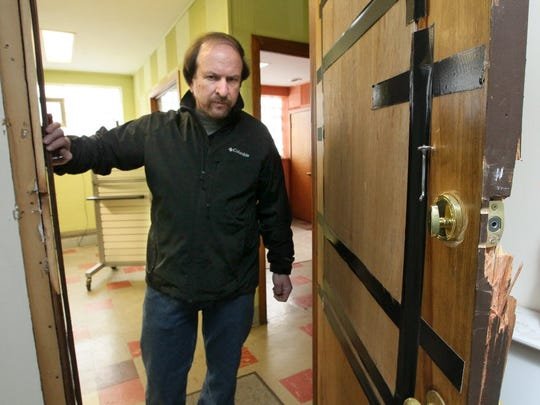 Dave Salkin unknowingly rented his building in Milwaukee to ATF agents, who ran an undercover sting out of it. He is pictured here in 2013 showing damage to his building.