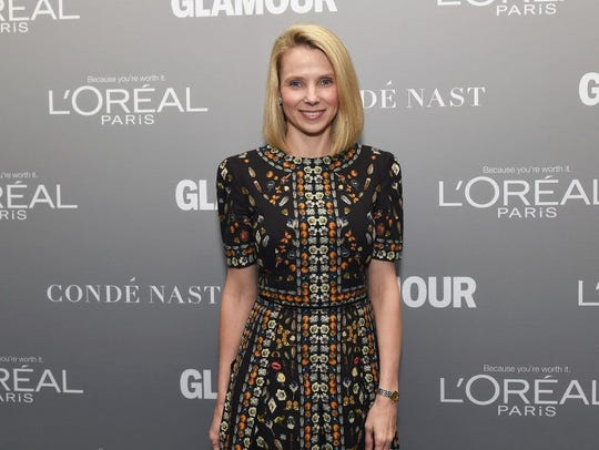 Marissa Mayer poses on the red carpet at the Glamour