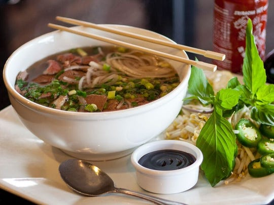 Pho soup and garnishes at Young's Cafe, which turns