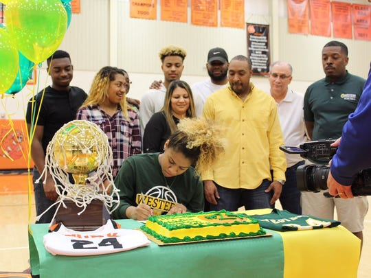 Burkburnett senior Paradize Jackson signed to play basketball at Western Oklahoma State College on Thursday. She was Burk's leading scorer the past three seasons.
