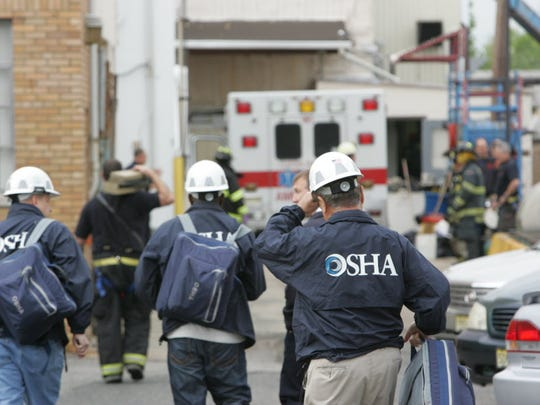 In this May 2012 file photo, an OSHA team arrives at the site of an industrial accident in Clifton.