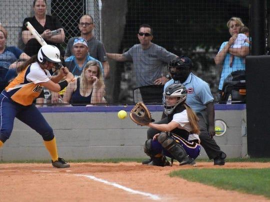 A Northeast batter watches the ball reach Clarksville's