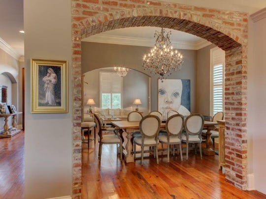The dining area opens to both a living area and kitchen space.