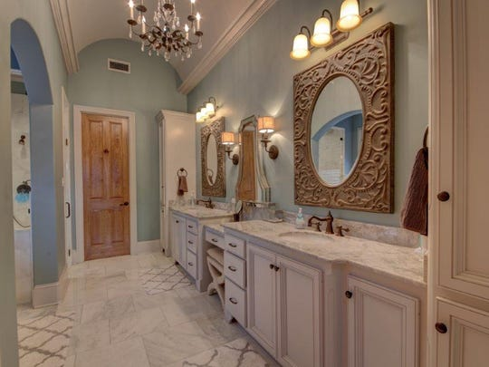 The master bath includes a soaking tub and spa - like shower.
