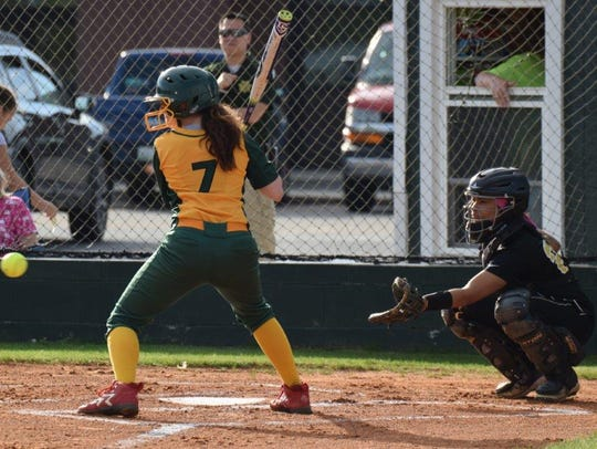 A Northwest player watches as a pitch come in toward